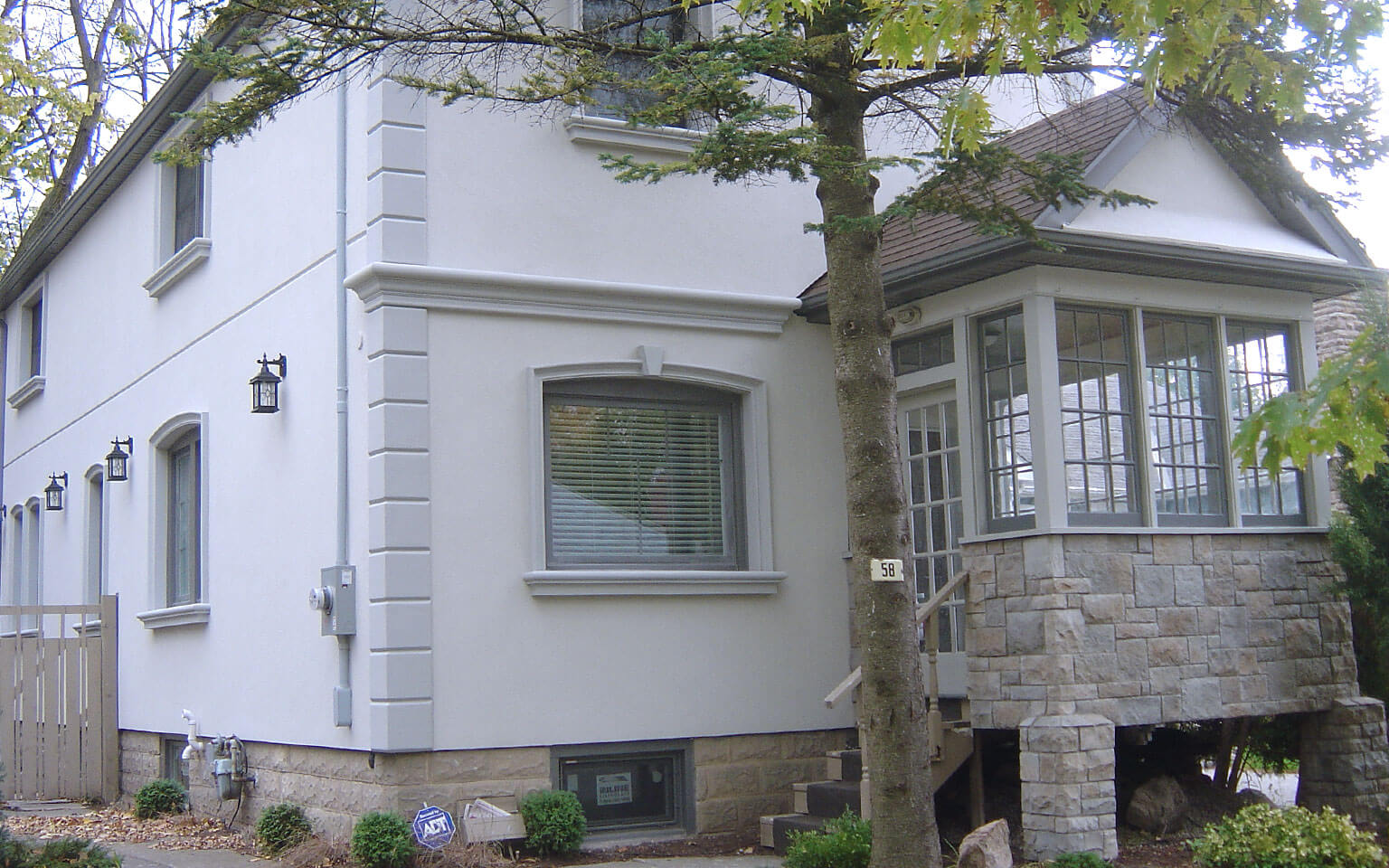Exterior house stucco finish building blocks construction for Exterior finishes for homes