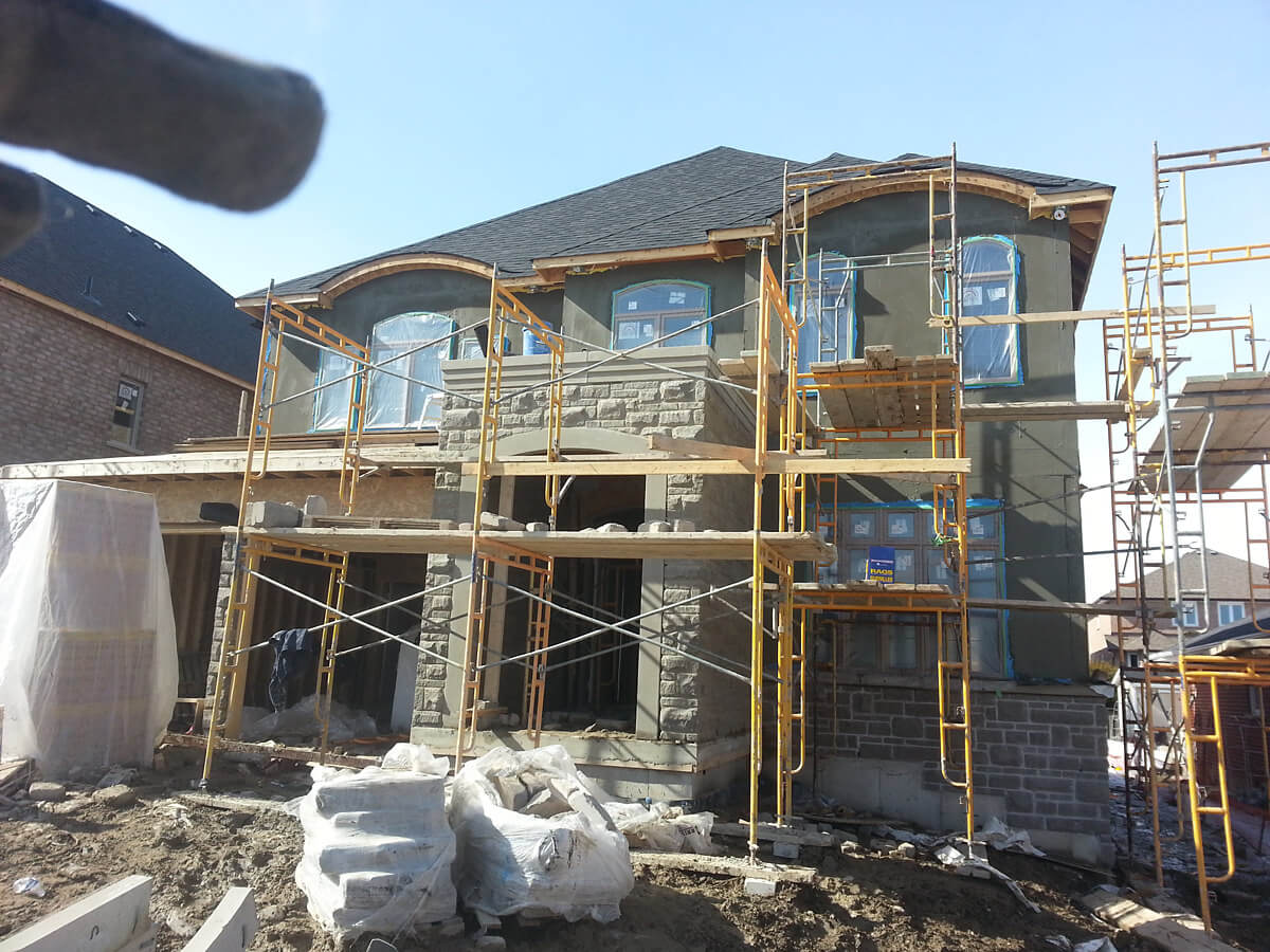 New house stone veneere and stucco confederation pkwy for House of granite and marble