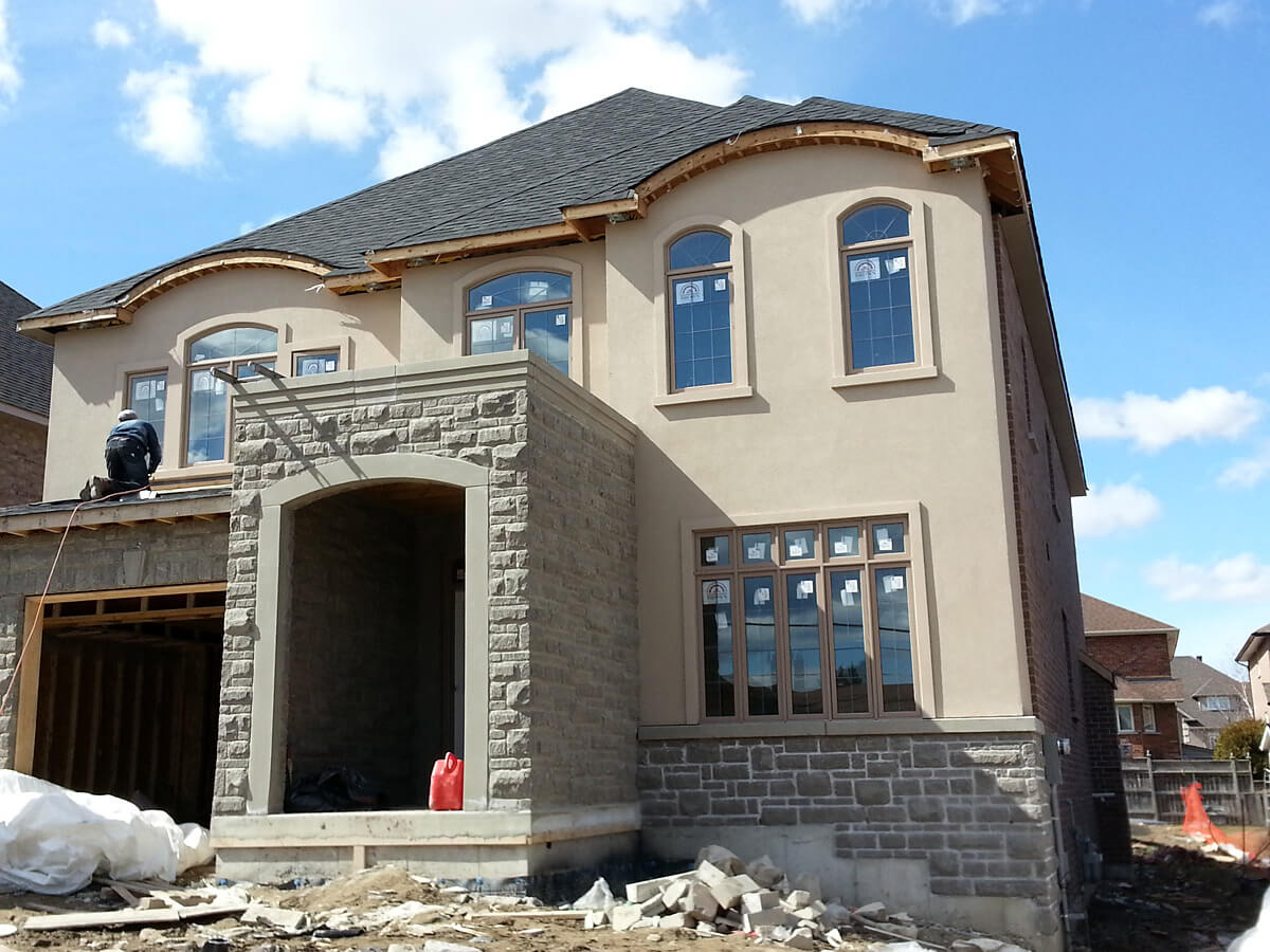 New house stone veneere and stucco confederation pkwy for Stucco facade