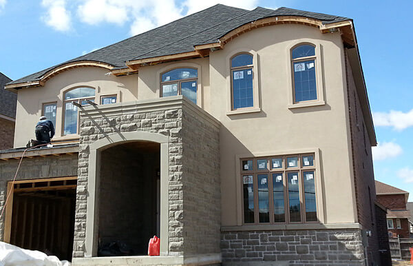 New house stone veneere and stucco confederation pkwy mississauga building blocks construction How to plaster a house exterior