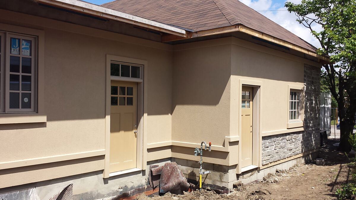 Home renovation stucco finish application building for Exterior standalone retail