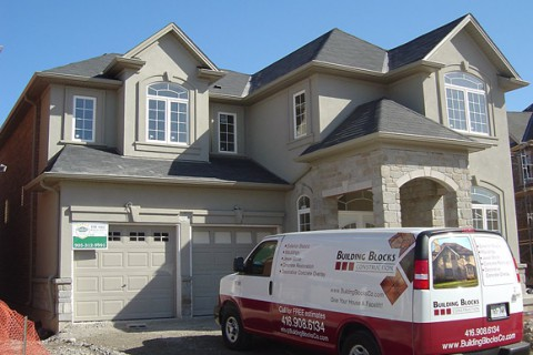 Burlington, New Home – Stucco and Stone Application