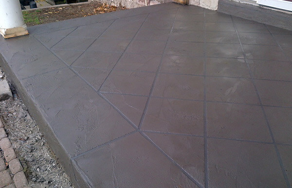 Exterior Concrete Repair and Resurface - Coloured Concrete Overlay