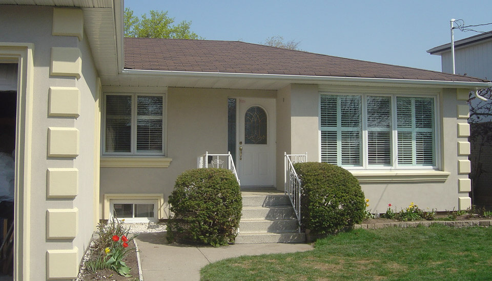 House with Restored Stucco - After Photo