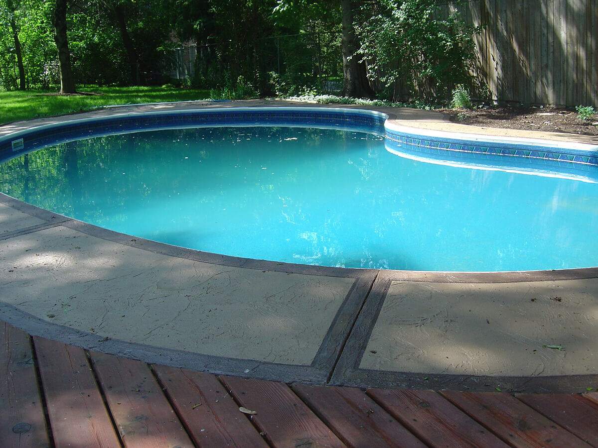 Outdoor pool deck decorative concrete overlay - Jewel Stone