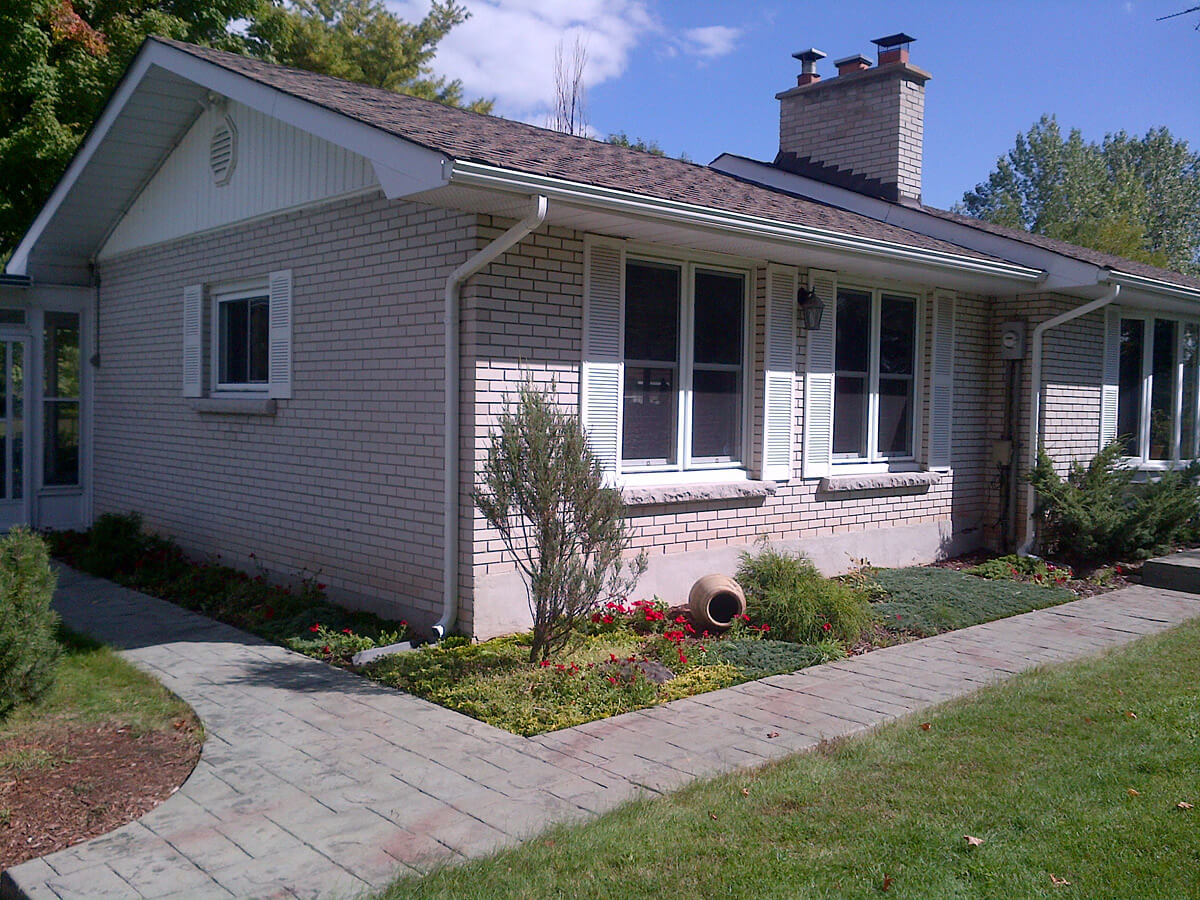 Residential home before stone and stucco renovation