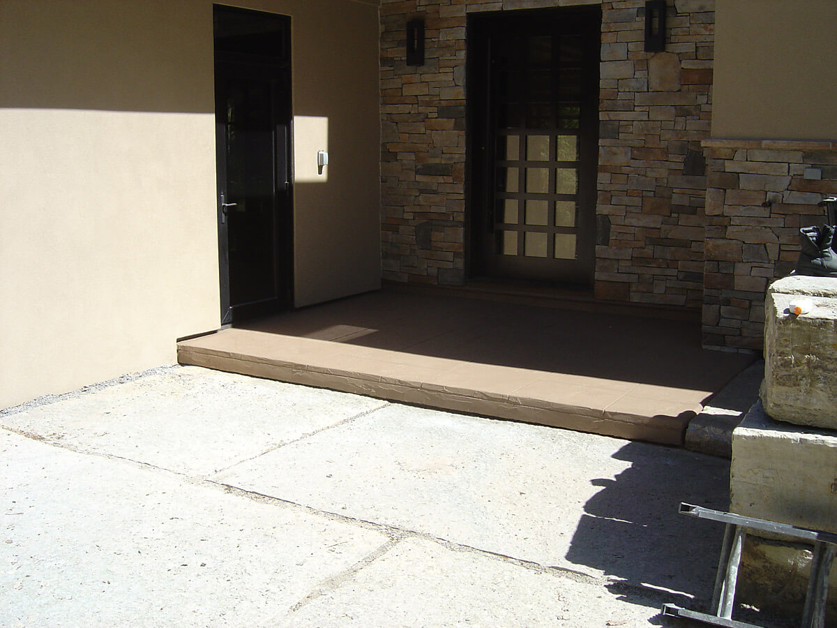 Side Entrance - Non-Slippery Cement Overlay