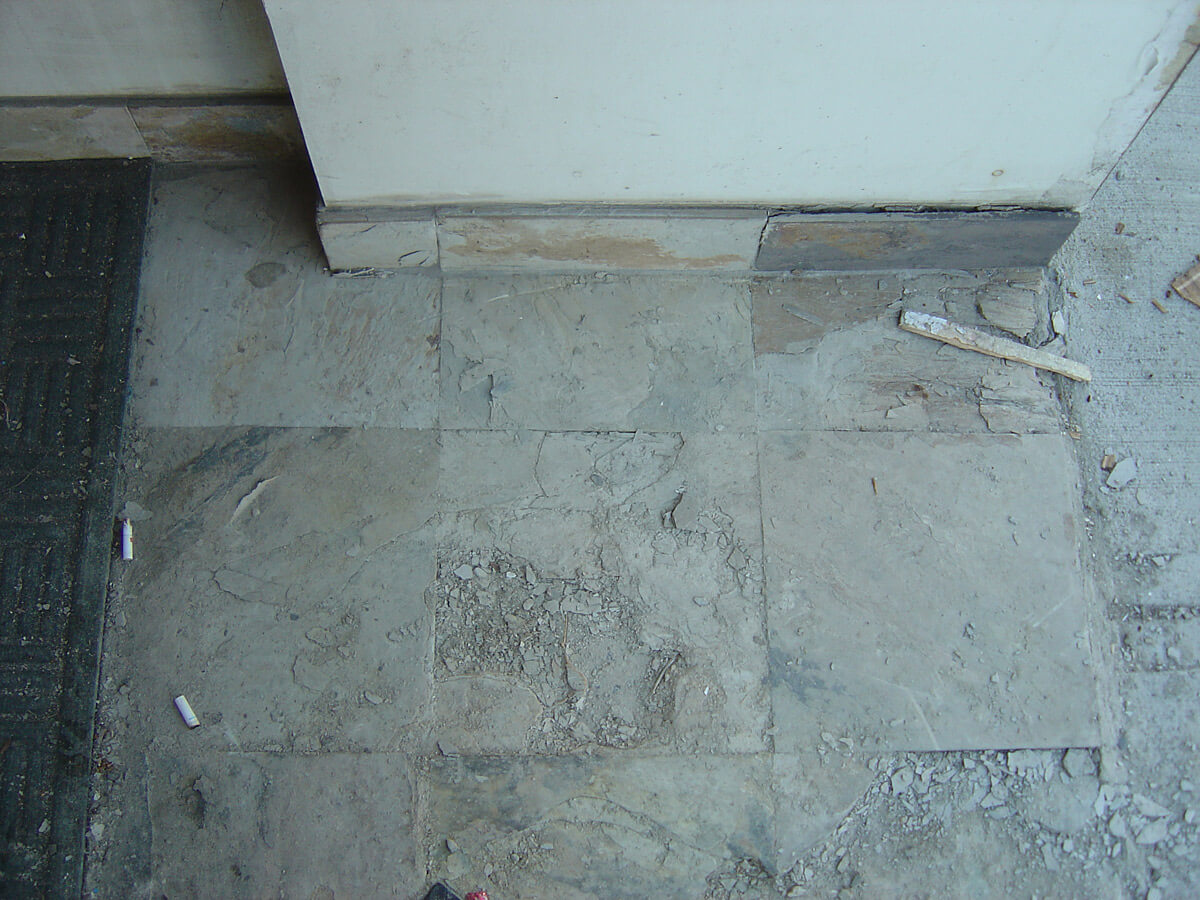Broken store front entrance - Concrete Repair and Restoration